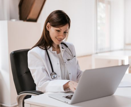 Female doctor at work using laptop